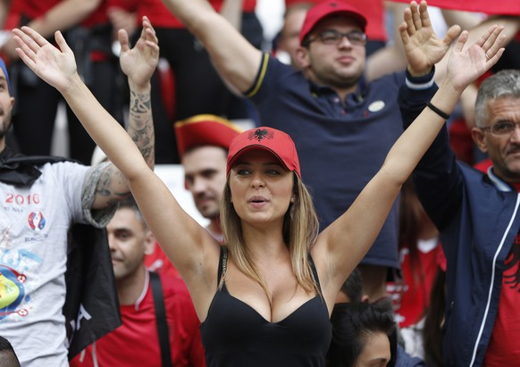 epa05367712 A supporter of Albania before the UEFA EURO 2016 group A preliminary round match between France and Albania at Stade Velodrome in Marseille, France, 15 June 2016.  (RESTRICTIONS APPLY: For editorial news reporting purposes only. Not used for commercial or marketing purposes without prior written approval of UEFA. Images must appear as still images and must not emulate match action video footage. Photographs published in online publications (whether via the Internet or otherwise) shall have an interval of at least 20 seconds between the posting.)  EPA/TOLGA BOZOGLU   EDITORIAL USE ONLY