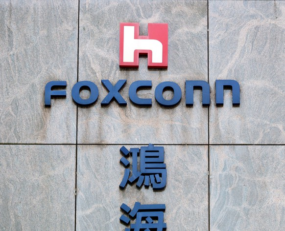 epa05935746 A view of the logo on the Hon Hai Foxconn plant in Neihu, Taipei, Taiwan, 29 April 2017. Hon Hai and Foxconn Chairman Terry Gou visited the White House on both 27 and 28 April 2017. On 28 April, leaving the Whilte House, Gou told reporters that Foxconn is planning an investment in the US. 'We are planning a number of investments in America. This project will include both capital-intensive, skilled-labour-intensive and high-tech investment. We are not final yet. I think we will share (announce the outcome) with you in the summer, maybe a few weeks,