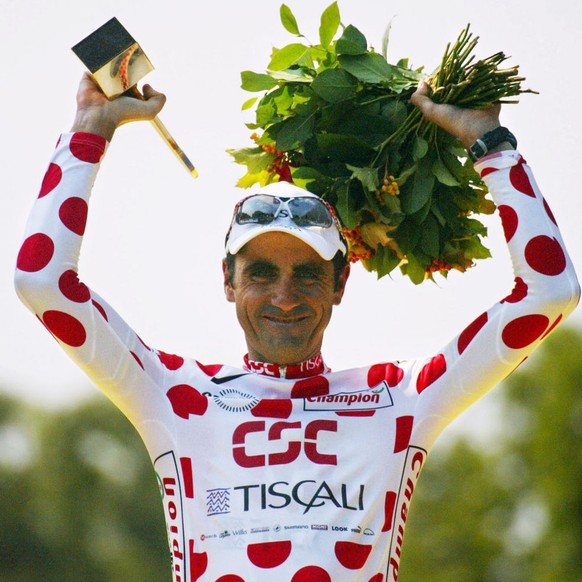 TDF024 - 20020728 - PARIS, FRANCE : Polka-dot jersey of best climber, the leader of the Danish CSC-Tiscali team, French Laurent Jalabert  celebrates on the podium on the 'Champs Elysees' after the last stage of the 89th French cycling race in Paris, Sunday 28 July 2002. EPA PHOTO  AFP / JOEL SAGET /lc-seb