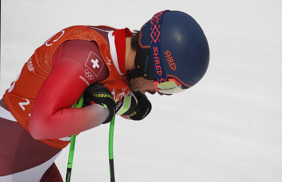Switzerland's Carlo Janka reacts in the finish area after completing men's downhill training at the 2018 Winter Olympics in Jeongseon, South Korea, Saturday, Feb. 10, 2018. (AP Photo/Christophe Ena)