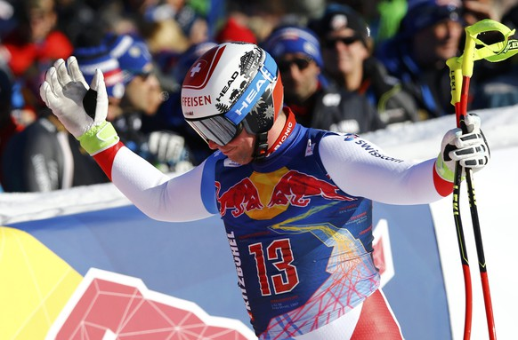 Alpine Skiing - FIS Alpine Skiing World Cup - Men's Downhill Race - Kitzbuehel, Austria - 21/01/17 - Beat Feuz of Switzerland reacts at the finish line. REUTERS/Leonhard Foeger