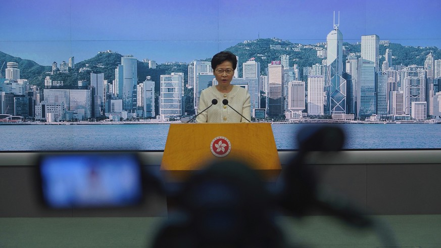Hong Kong Chief Executive Carrie Lam listens to reporters' questions during a press conference in Hong Kong, Tuesday, July 7, 2020. TikTok said Tuesday it will stop operations in Hong Kong, joining other social media companies in warily eyeing ramifications of a sweeping national security law that took effect last week.(AP Photo/Vincent Yu) Carrie Lam