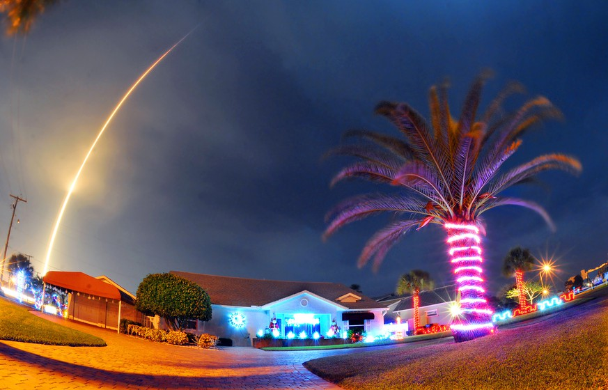 The SpaceX Falcon 9 rocket lifts off over Cocoa Beach, Fla., at Cape Canaveral Air Force Station, Monday, Dec. 21, 2015. The rocket, carrying several communications satellites for Orbcomm, Inc., is the first launch of the rocket since a failed mission to the International Space Station in June. (Craig Rubadoux/Florida Today via AP)  NO SALES; MANDATORY CREDIT