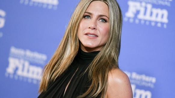 FILE - In this Jan. 30, 2015 file photo, actress Jennifer Aniston arrives at the 30th Santa Barbara International Film Festival Montecito Award ceremony in Santa Barbara, Calif. Aniston and Julia Roberts will join other celebrities for NBC's