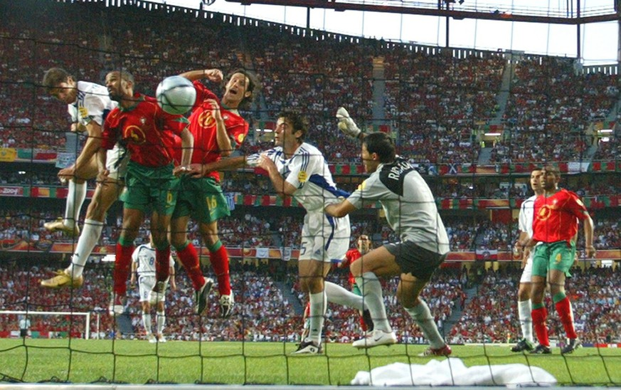 Greek striker Angelos Charisteas (left) scores the 1-0 lead during the Euro 2004 final between Portugal and Greece at Luz stadium in Lisbon on Sunday, 04 July 2004.  EPA/ANTONIO SIMOES NO MOBILE PHONE APPLICATIONS