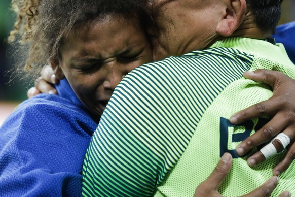 Brazil's Rafaela Silva, left, reacts after winning the gold medal of the women's 57-kg judo competition at the 2016 Summer Olympics in Rio de Janeiro, Brazil, Monday, Aug. 8, 2016. (AP Photo/Markus Schreiber)