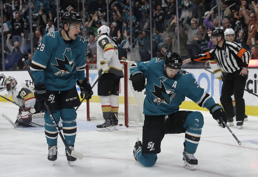 San Jose Sharks center Logan Couture, right, celebrates with right wing Timo Meier (28) after scoring a goal against the Vegas Golden Knights during the first period of an NHL hockey game in San Jose, Calif., Monday, March 18, 2019. (AP Photo/Jeff Chiu)