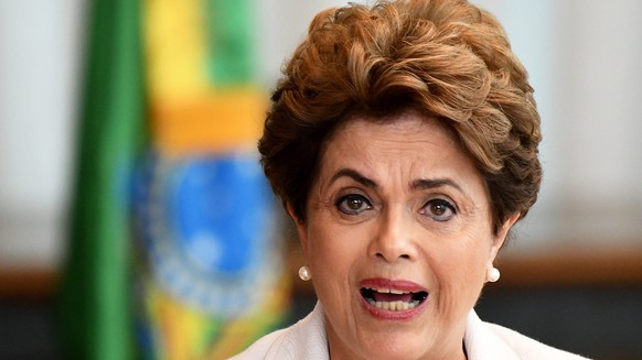 epa05490953 Suspended Brazilian President Dilma Rousseff reads her letter to the Brazilian people and senators, during a press conference in Brasilia, Brazil, 16 August 2016. Rousseff promised to immediately hold a new round of elections if the impeachment process against her is suspended. Rousseff, who was suspended from office on 12 May, is accused of various budget irregularities.  EPA/Cadu Gomes