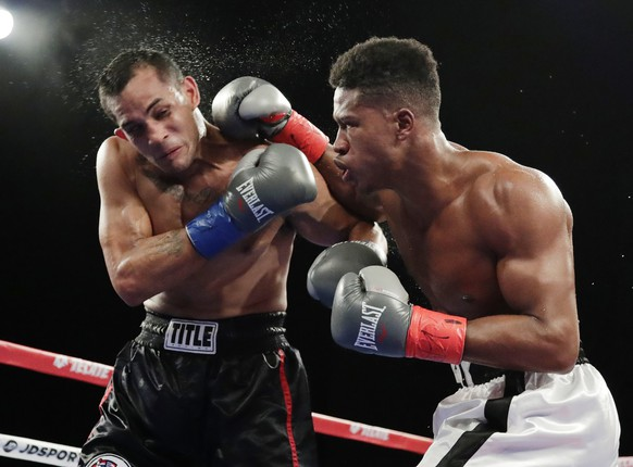 Patrick Day, right, punches Elvin Ayala during the fifth round of a WBC Continental Americas super welterweight championship boxing match Saturday, Oct. 27, 2018, in New York. Day won the fight. (AP Photo/Frank Franklin II)