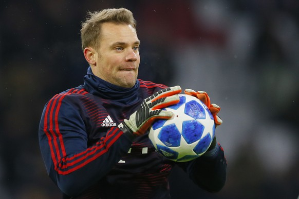 Bayern goalkeeper Manuel Neuer warms up prior to the Champions League group E soccer match between Ajax and FC Bayern Munich at the Johan Cruyff Arena in Amsterdam, Netherlands, Wednesday, Dec. 12, 2018. (AP Photo/Peter Dejong)