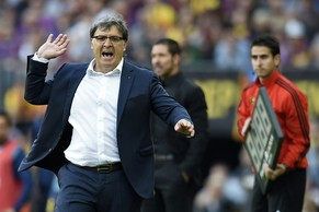 "Barcelona's Argentinian coach Gerardo ""Tata"" Martino reacts during the Spanish league football match FC Barcelona vs Club Atletico de Madrid  at the Camp Nou stadium in Barcelona on May 17, 2014.   AFP PHOTO/ LLUIS GENE"