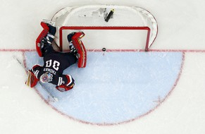 Goaltender Tim Thomas of the U.S. reacts after a goal of Russia's Alexander Ovechkin (unseen) during the first period of their men's ice hockey World Championship group B game at Minsk Arena in Minsk May 12, 2014.   REUTERS/Alexander Demianchuk (BELARUS  - Tags: SPORT ICE HOCKEY TPX IMAGES OF THE DAY)