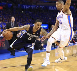 Memphis Grizzlies guard Courtney Lee (5) drives to the basket around Oklahoma City Thunder guard Thabo Sefolosha (25) during the first quarter of Game 1 of the opening-round NBA basketball playoff series in Oklahoma City on Saturday, April 19, 2014. (AP Photo/Alonzo Adams)
