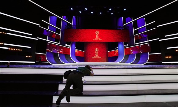epa06359796 A photographer takes pictures of the stage on the eve of the FIFA World Cup 2018 Final Draw in the State Kremlin Palace in Moscow, Russia, 30 November 2017. The Final Draw for the FIFA World Cup 2018 in Russia will take place in Moscow on 01 December 2017.  EPA/SERGEI ILNITSKY
