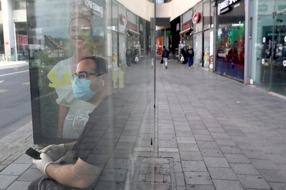 epaselect epa08297791 A man wearing a protective mask in a bus station in central Tel Aviv, Israel, 16 March 2020. Media reports that Israel bans gatherings of more than 10 people in the same place to prevent the spread of the Coronavirus COVID-19. The decision brought the tourism sites in Israel to a complete standstill, many hotels, restaurants, cafes, and theaters in the country are closed.  EPA/ABIR SULTAN