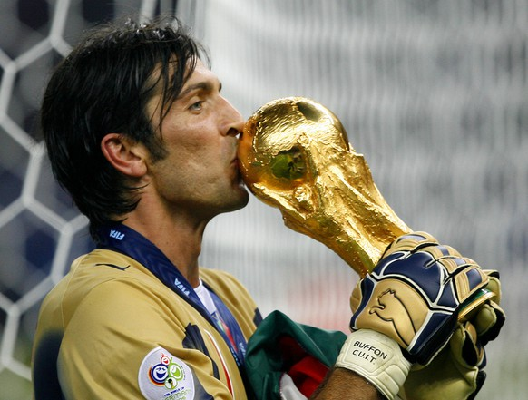 Italy's goal keeper Gianluigi Buffon kisses the World Cup trophy after the final of the soccer World Cup between Italy and France in the Olympic Stadium in Berlin, Sunday, July 9, 2006.  Italy beat France on penalties. (AP Photo/Jasper Juinen)  ** MOBILE/PDA USAGE OUT **