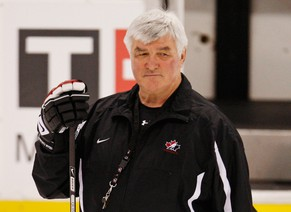 Canada's head coach Pat Quinn watches his team's practice at the 2009 IIHF U20 World Junior Hockey Championships in Ottawa, in this file photo from January 4, 2009.  Quinn, a co-owner of the Canadian Hockey League's Vancouver Giants, died November 23, 2014, after a lengthy illness, the team announced November 24.  REUTERS/Shaun Best/Files     (CANADA - Tags: SPORT ICE HOCKEY OBITUARY)