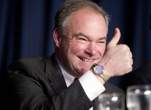 FILE - In this Feb. 4, 2016, file photo, Sen. Tim Kaine, D-Va., gives a 'thumbs-up' as he takes his seat at the head table for the National Prayer Breakfast in Washington. Kaine is one of several Democrats that Hillary Clinton is considering for her vice presidential running mate.  (AP Photo/Pablo Martinez Monsivais, File)