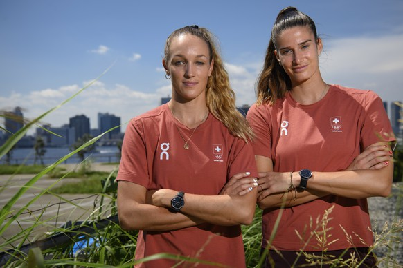 epa09355926 Swiss athletes in beach volleyball Joana Heidrich (R) and Anouk Verge-Depre pose for photographers after a virtual press conference at the 2020 Summer Olympics, in Tokyo, Japan, 21 July 2021.  EPA/LAURENT GILLIERON EDITORIAL USE ONLY