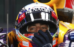 "Red Bull Formula One driver Daniel Ricciardo of Australia adjusts his helmet as he waits in his car during the third practice session of the Malaysian F1 Grand Prix at Sepang International Circuit outside Kuala Lumpur, March 29, 2014. Written at the bottom of his helmet is a message for the missing Malaysia Airlines flight MH370 that reads, ""Pray for MH370."" REUTERS/Edgar Su (MALAYSIA  - Tags: SPORT MOTORSPORT F1)"