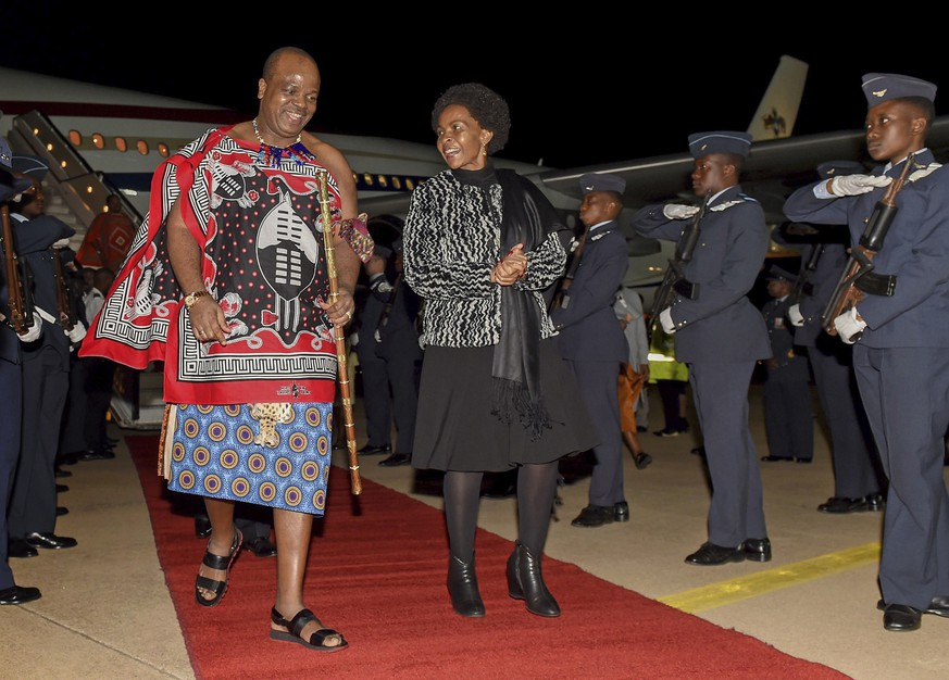 epa07598533 epa07598529 A handout photo made available by the South African government's Department of International Relations and Cooperation's (DIRCO) shows King Mswati III of Eswatini  head of the Swazi Royal Family (L) arrives at Waterkloof Airforce Base in Pretoria, South Africa, 24 May 2019. King Mswati III is in South Africa to attend the inauguration ceremony for South African president Cyril Ramaphosa at Loftus Versveld Stadium in Pretoria on 25 May 2019.  EPA/Jacoline Schoonees/DIRCO/RSA /HANDO  HANDOUT EDITORIAL USE ONLY/NO SALES