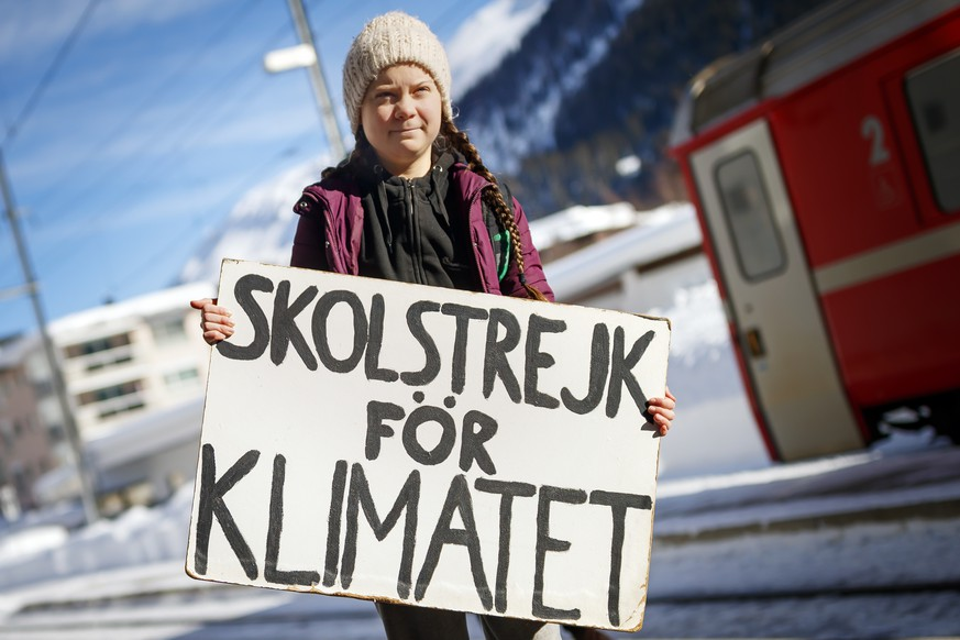 16 year-old Swedish climate activist Greta Thunberg arrives to attend the 49th Annual Meeting of the World Economic Forum, WEF, in Davos, Switzerland, Wednesday, January 23, 2019. Starting the first school strike for climate outside the Swedish parliament building aiming to raise awareness of global warming Greta Thunberg has inspired tens of thousands of student over the globe to organize their own strikes to further raise government awareness on climate change. (KEYSTONE/Valentin Flauraud)