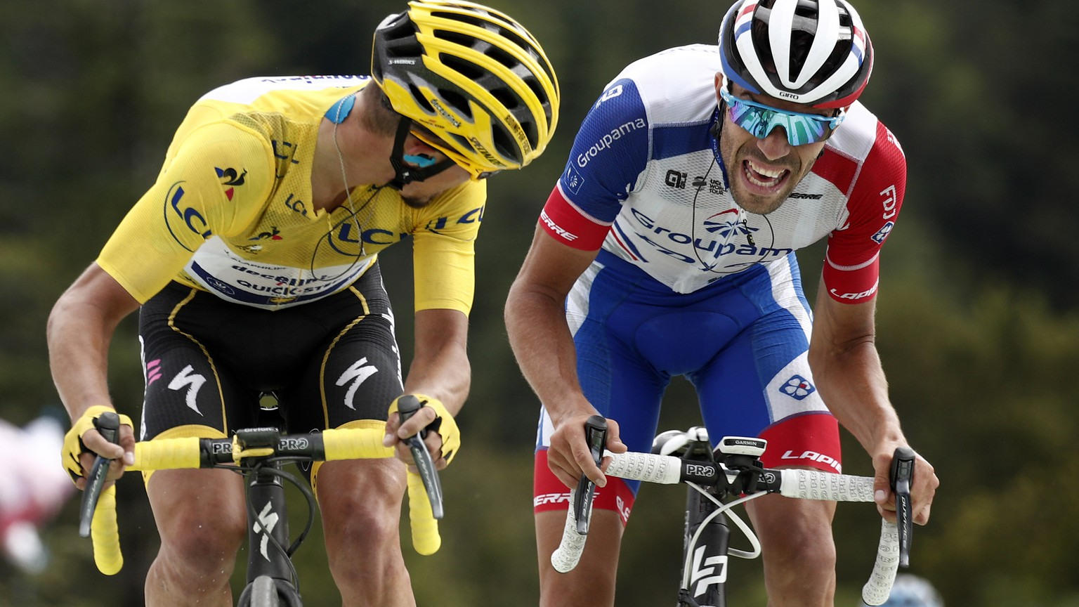 epa07710453 France's Julian Alaphilippe (L) of Deceuninck Quick Step team and France's Thibaut Pinot (R) of Groupama Fdj team cross the finish line  during the 6th stage of the 106th edition of the Tour de France cycling race over 160.5km between Mulhouse and La Planche des Belles Filles, France, 11 July 2019.  EPA/YOAN VALAT
