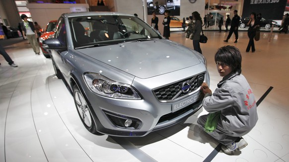 epa04547440 (FILE) A file photo dated 23 April 2010 showing a man polishing a Volvo Electric C30 during the preview day for members of the press at the Beijing Auto Show in Beijing, China. China-owned Volvo Cars on 05 January 2015 reported a 8.9-per-cent rise in global sales in 2014 on the previous year, citing strong growth in China and Western Europe. The carmaker said it sold 465,866 cars in the year, roughly 7,000 more cars than during the previous record year of 2007.In 2014, China became the company's main market, where it sold 81,221 cars. The increase of 32.8 per cent on 2013 was driven by the Volvo XC60, the S60L sedan and the V40 models. In Western Europe, it sold 243,513 cars. The three top markets in the region were Sweden, Britain and Germany.  EPA/DIEGO AZUBEL