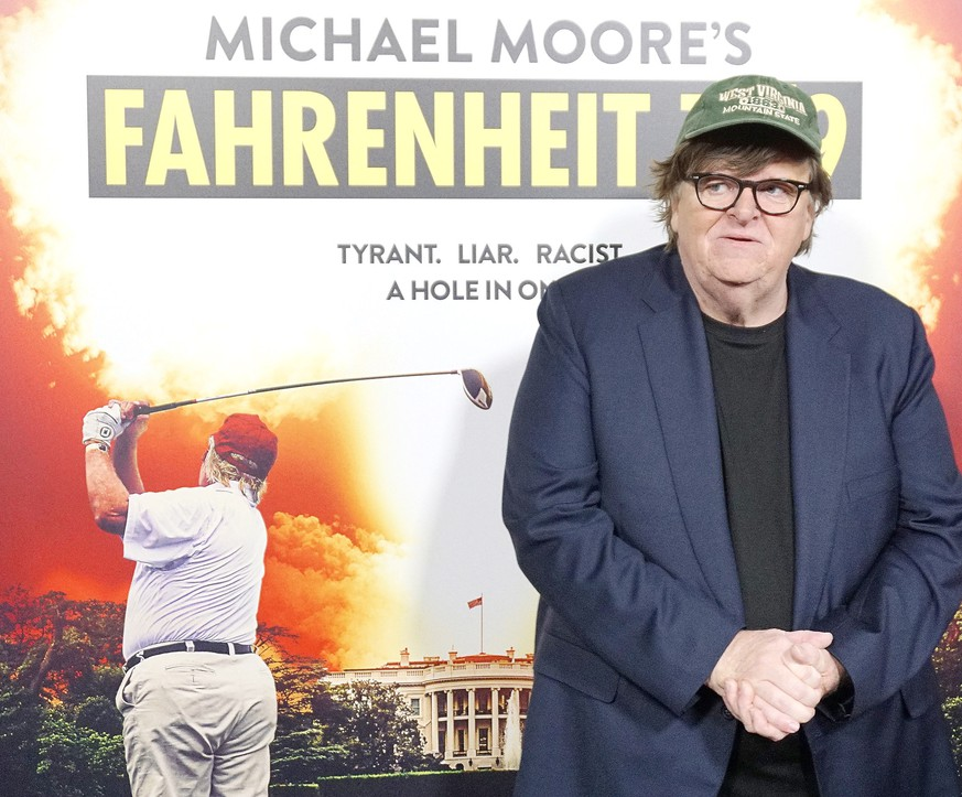 epa07033788 US producer Michael Moore arriving at the premiere of Briarcliff Entertainment's Fahrenheit 11/9 at Samuel Goldwyn Theater in Beverly Hills, California, USA 19 September 2018. The movie opens in the US 21 September 2018.  EPA/NINA PROMMER