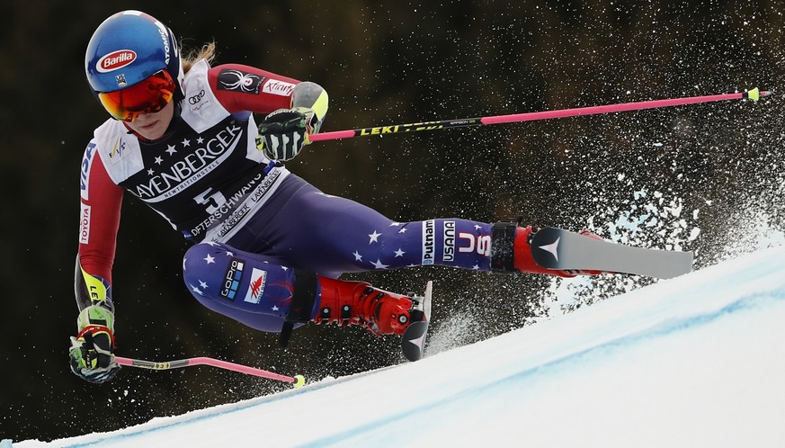 United States' Mikaela Shiffrin speeds down the course during an alpine ski, women's World Cup giant slalom, in Ofterschwang, Germany, on March 9, 2018. (AP Photo/Gabriele Facciotti)