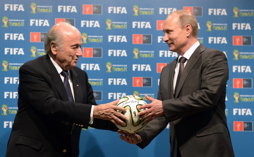 In this photo taken on Sunday, July 13, 2014, FIFA President Sepp Blatter, left, and Russian President Vladimir Putin are seen during the official ceremony of handover to Russia as the 2018 World Cup hosts, after the World Cup final soccer match between Germany and Argentina at the Maracana Stadium in Rio de Janeiro, Brazil.  (AP Photo/RIA-Novosti, Alexei Nikolsky, Presidential Press Service)