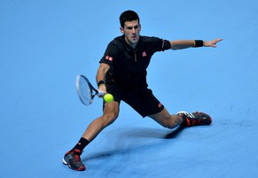 Serbia's Novak Djokovic returns to Croatia's Marin Cilic during their Group A singles match on day two of the ATP World Tour Finals tennis tournament in London on November 10, 2014.  AFP PHOTO/GLYN KIRK