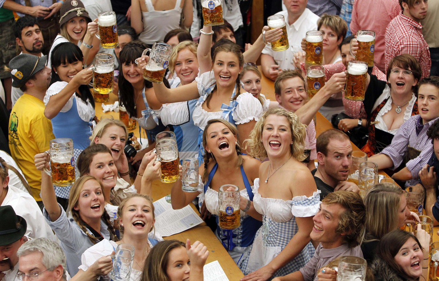 Young women toast with beer after the opening of the Oktoberfest beer festival in Munich, southern Germany, Saturday, Sept. 18, 2010. People from around the world are expected to the biggest and most famous beer festival Oktoberfest which runs from Sept. 18 until Oct.  4 and marks its 200th anniversary this year. (AP Photo/Matthias Schrader)