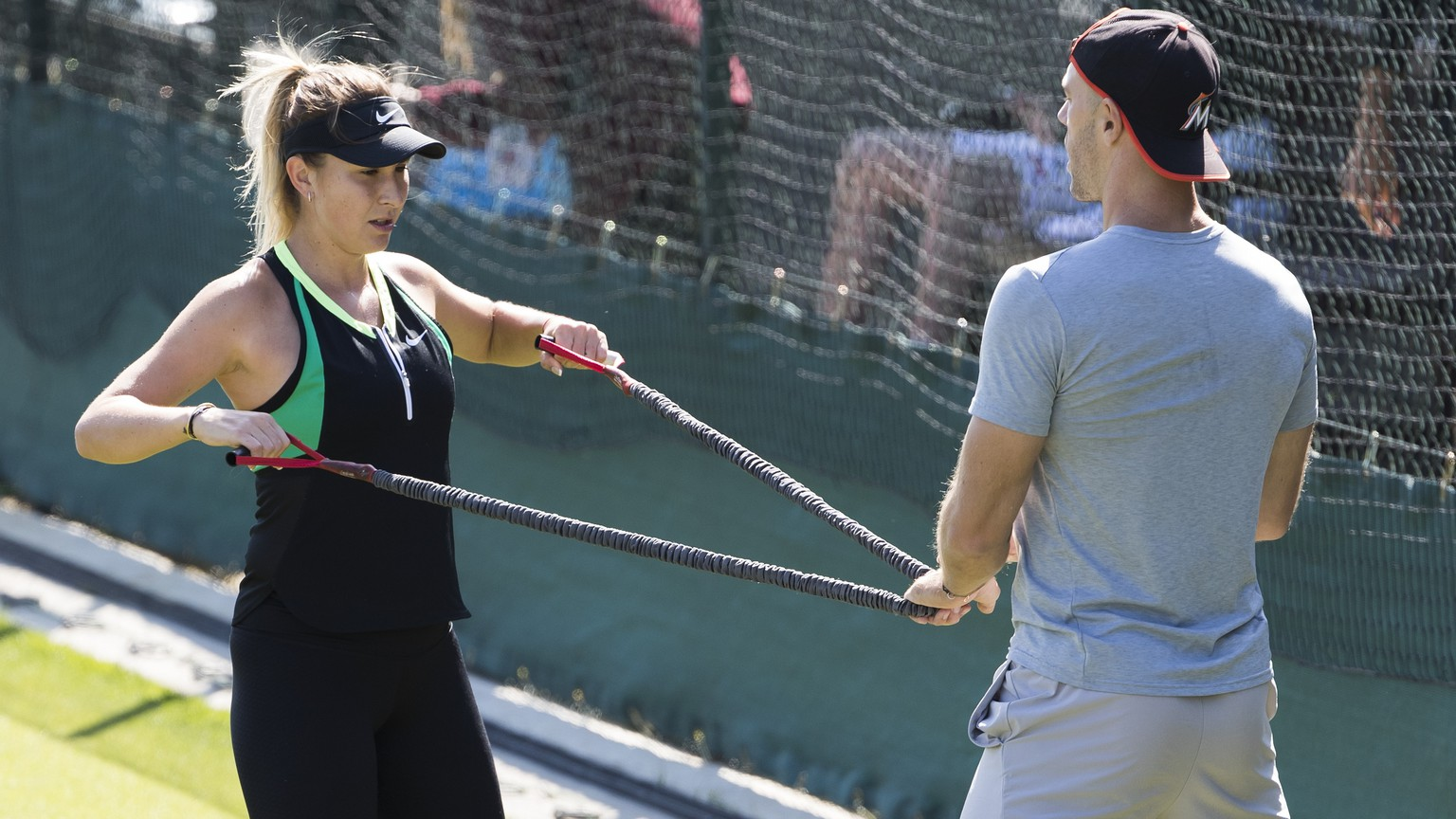 Belinda Bencic of Switzerland and her fitness coach Martin Hromkovic during a training session at the All England Lawn Tennis Championships in Wimbledon, London, Wednesday, June 27, 2018. The Wimbledon Tennis Championships 2018 will be held in London from 2 July to 15 July. (KEYSTONE/Peter Klaunzer)
