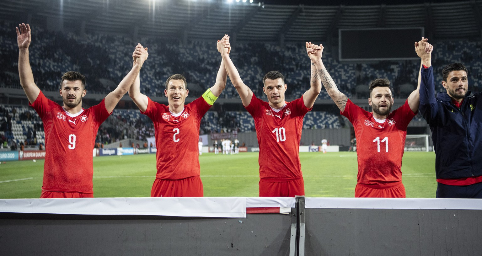 epa07458667 The team of Switzerland reacts after the UEFA Euro 2020 qualifier Group D soccer match between Georgia and Switzerland at the Boris Paichadze National Stadium in Tbilisi, Georgia, 23 March 2019.  EPA/ENNIO LEANZA