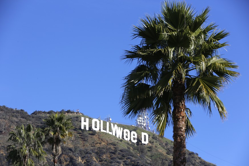 The Hollywood sign is seen vandalized Sunday, Jan. 1, 2017. Los Angeles residents awoke New Year's Day to find a prankster had altered the famed Hollywood sign to read