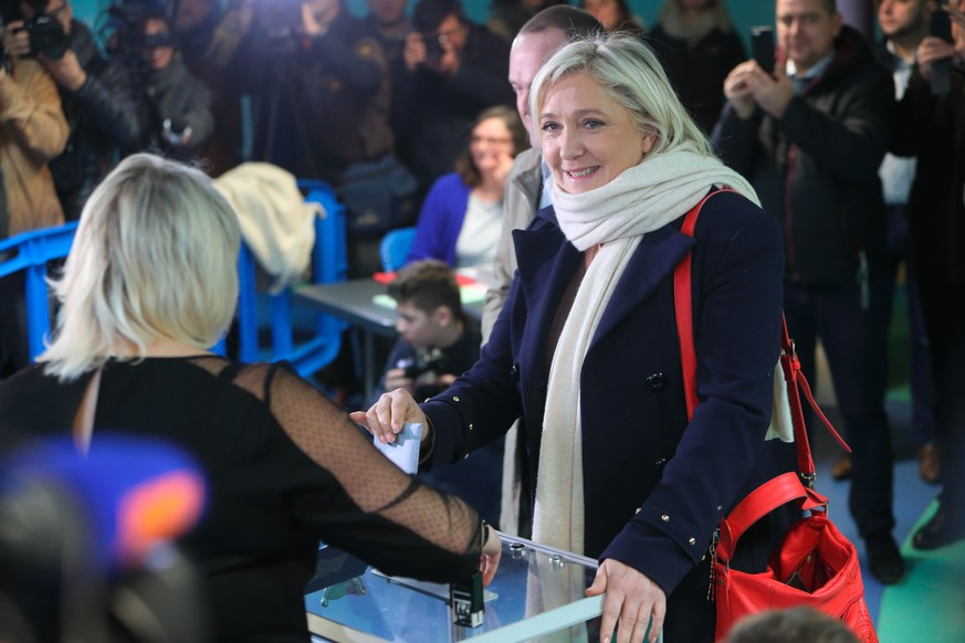 HENIN-BEAUMONT, FRANCE - DECEMBER 06:  French Far-Right National Front President Marine Le Pen prepares to vote in for the first round of regional elections, on December 6, 2015 in Henin-Beaumont, France. Voting is under way in France's regional elections, which are being held under a continued state of emergency following the Paris terror attacks. (Photo by Sylvain Lefevre/Getty Images)