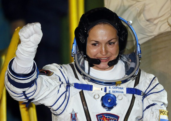 epa04417469 Russian cosmonaut Elena Serova during farewell ceremony as they get up into the spacecraft Soyuz TMA 14 M before the launch at the Baikonur Cosmodrome, Kazakhstan, 26 September 2014. The crew is set to launch to the International Space Station (ISS) from the Baikonur Cosmodrome.  EPA/YURI KOCHETKOV