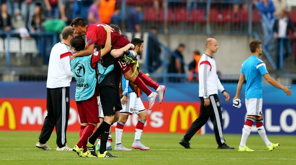 OLOMOUC, CZECH REPUBLIC - JUNE 27:  Jose Sa, goalkeeper of Portugal celebrte with team mate Ricardo Horta after the UEFA European Under-21 semi final match Between Portugal and Germany at Ander Stadium on June 27, 2015 in Olomouc, Czech Republic.  (Photo by Martin Rose/Getty Images)