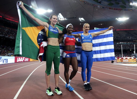From left: Brazil's Fabiana Murer, silver, Cuba's Yarisley Silva, gold, and Greece's Nikoleta Kyriakopoulou, bronze, celebrate after the women's pole vault final at the World Athletics Championships at the Bird's Nest stadium in Beijing, Wednesday, Aug. 26, 2015.  (AP Photo/Andy Wong)