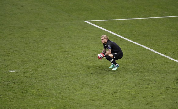 epa06765790 Liverpool's goalkeeper Loris Karius reacts after conceding Real Madrid's 3-1 lead during the UEFA Champions League final between Real Madrid and Liverpool FC at the NSC Olimpiyskiy stadium in Kiev, Ukraine, 26 May 2018. EPA/ROBERT GHEMENT
