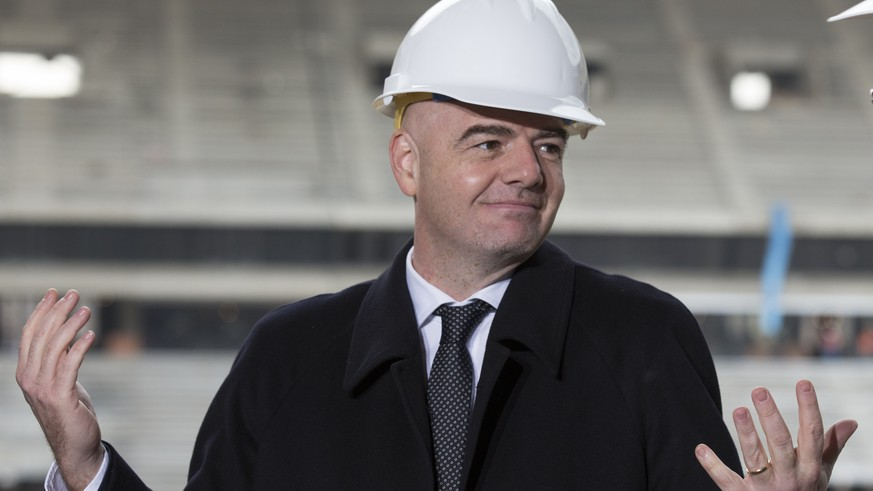 FIFA President Gianni Infantino gestures at the Luzhniki Stadium which is undergoing a major rebuild to be ready for the 2018 World Cup during a visit with Moscow's Mayor Sergei Sobyanin, in Moscow, Russia, Tuesday, April 19, 2016. Gianni Infantino is visiting 2018 World Cup host Russia for the first time since he was elected FIFA president in February. (AP Photo/Alexander Zemlianichenko)