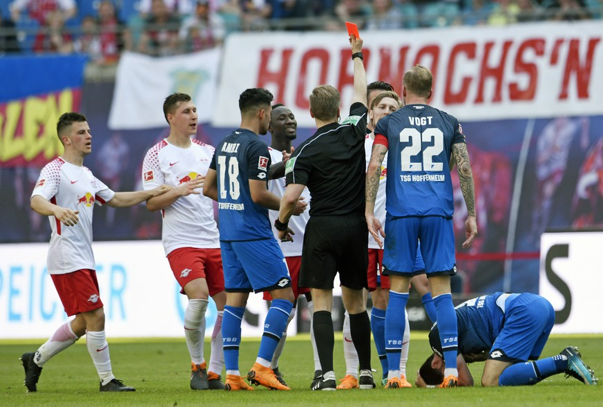 Leipzig's Emil Forsberg, 3rd of right, received a red card during the German first division Bundesliga soccer match between RB Leipzig and TSG Hoffenheim in Leipzig, Germany, Saturday, April 21, 2018. (AP Photo/Jens Meyer)
