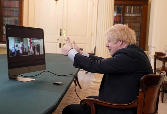 epa08410308 A handout photo made available by n 10 Downing street shows Britain's Prime Minister Boris Johnson video chating with WWII veteran Ernie Horsfall, 102,  from the cabinet room in n10 Downing street in London, Britain 08 May 2020. Ernie served in the Army from 1940 to 1946 as part of the Royal Electrical and Mechanical Engineers (REME)  EPA/ANDREW PARSONS / HANDOUT This image is for Editorial use purposes only. The Image can not be used for advertising or commercial use. The Image can not be altered in any form. Credit should read Andrew Parsons/n10 Downing street. HANDOUT EDITORIAL USE ONLY/NO SALES
