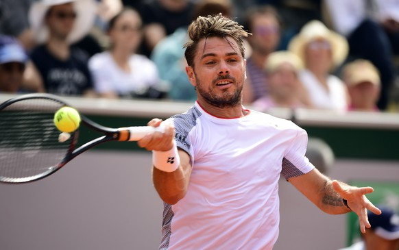 epa07605946 Stan Wawrinka of Switzerland plays Jozef Kovalik of Slovakia during their men's first round match during the French Open tennis tournament at Roland Garros in Paris, France, 27 May 2019.  EPA/CAROLINE BLUMBERG
