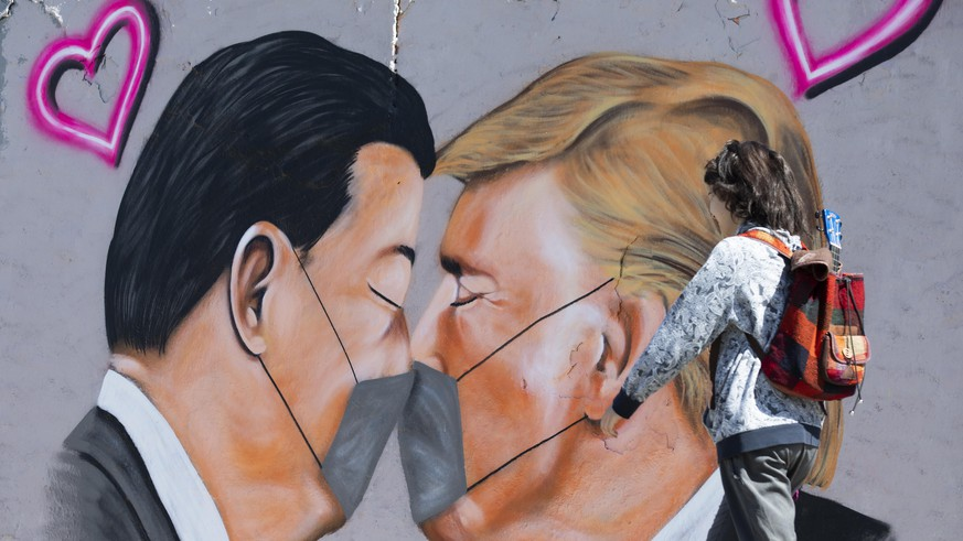 BERLIN, GERMANY - APRIL 27: Graffitis of U.S. President Donald Trump and President of the People's Republic of China Xi Jinping wearing face mask to draw attention to novel coronavirus (Covid-19) pandemic at Mauer Park in Berlin, Germany on April 27, 2020. (Photo by Abdulhamid Hosbas/Anadolu Agency via Getty Images)