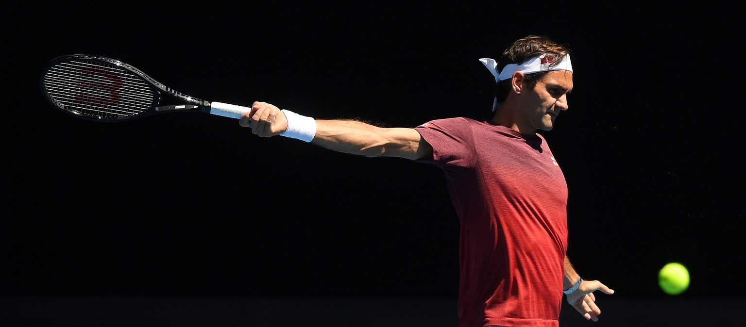 epa07279526 Roger Federer of Switzerland in action during a training session prior to the 2019 Australian Open tennis tournament in Melbourne, Australia, 13 January 2019.  EPA/LUKAS COCH EDITORIAL USE ONLY AUSTRALIA AND NEW ZEALAND OUT