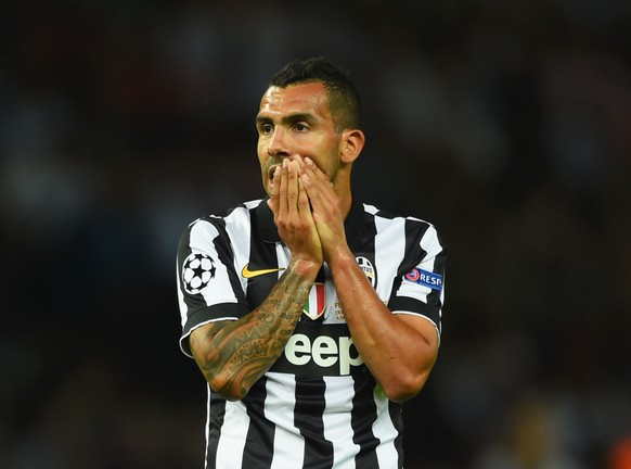 BERLIN, GERMANY - JUNE 06:  Carlos Tevez of Juventus reacts during the UEFA Champions League Final between Juventus and FC Barcelona at Olympiastadion on June 6, 2015 in Berlin, Germany.  (Photo by Shaun Botterill/Getty Images)