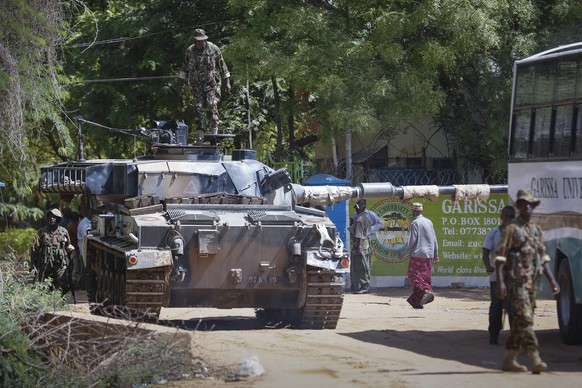 epa04689762 A Kenyan soldier stands on top of a tank in front of Garissa University in Garissa town, located near the border with Somalia, some 370km northeast of the capital Nairobi, Kenya, 02 April 2015. At least 15 people have been killed and some 60 were injured in an attack carried out by Somalia's Islamist militant group al-Shabab, according to local media reports.  EPA/DAI KUROKAWA