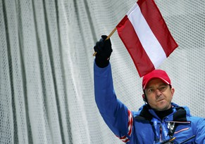 Austria's ski jumping head coach Alexander Pointner holds his flag during the men's team ski jumping final of the Sochi 2014 Winter Olympic Games, at the RusSki Gorki Ski Jumping Center in Rosa Khutor, February 17, 2014.    REUTERS/Dominic Ebenbichler (RUSSIA  - Tags: OLYMPICS SPORT SKIING)